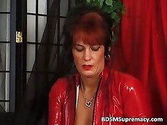 Leathery mistress in red takes
