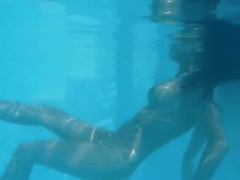 Naughty undine naked in the swimmingpool