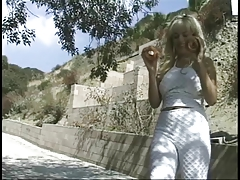 Blond chick giving handjob outdoors